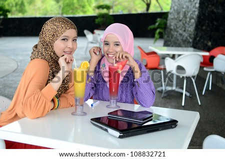 young muslim woman in head scarf drink at cafe - stock photo