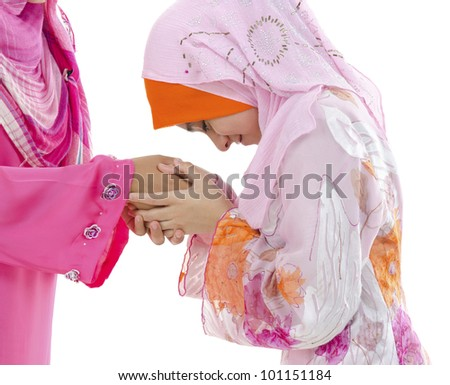 Young Muslim women greeting to elders