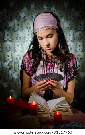 Young mystical woman playing fortune-teller