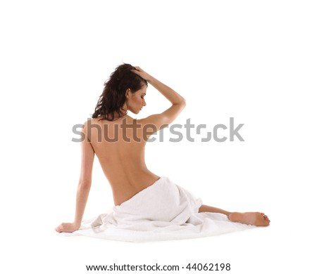 Young naked woman doing Yoga exercise
