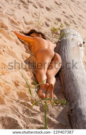 stock photo young naked woman sunbathing