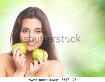 Young, natural and healthy brunette isolated on abstract blue background