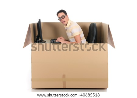 Young nerd, geek man having a chat session, chat box, cardboard box representing chat room.  Studio, white background