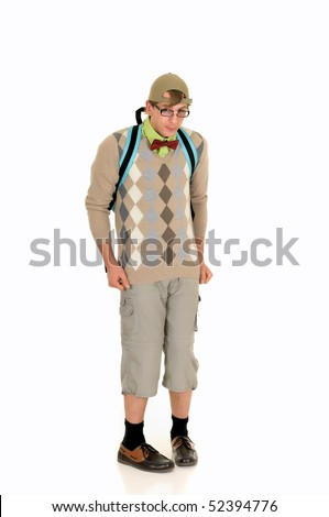 Young nerd with bow tie, shorts and cap, wearing backpack. Studio, white background