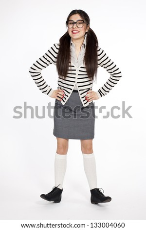 Young nerd woman funny position on white background