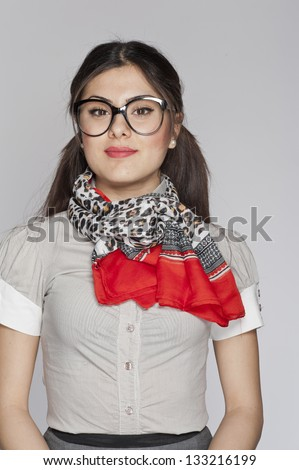 Young nerd woman posing on white background