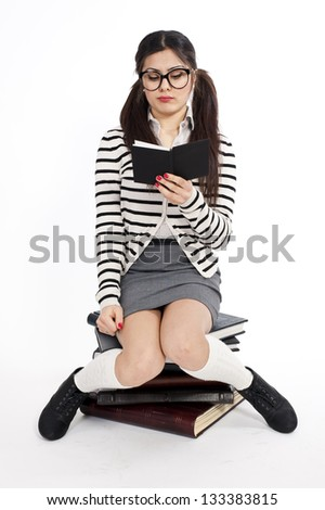 Young nerd woman studying, concentrated expression