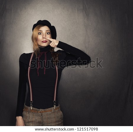 young nerdy girl compressing her nose on grunge background with copy space on left side