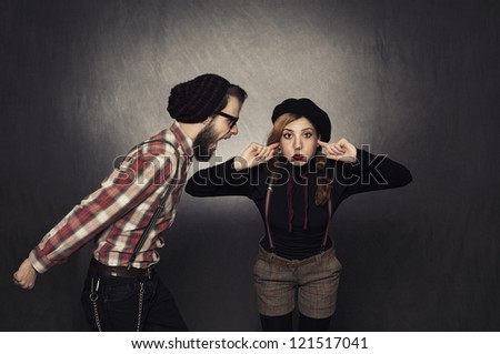 young nerdy girl not listening young nerdy man shouting on grunge background