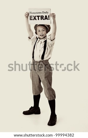 young newsboy holding up a newspaper