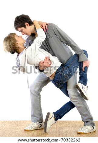 young nice couple dancing on white background