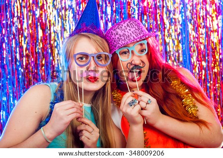 Young nice girls have fun on a dance party #348009206