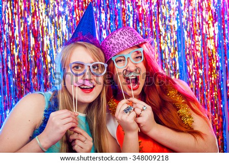 Young nice girls have fun on a dance party #348009218