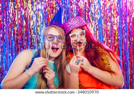 Young nice girls have fun on a dance party #348010970