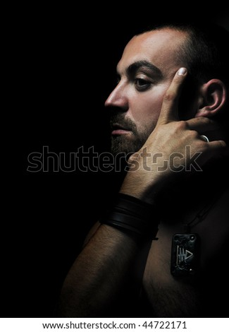 stock photo : young nude adult man face portrait in dark