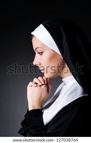 Young nun in religious concept - stock photo