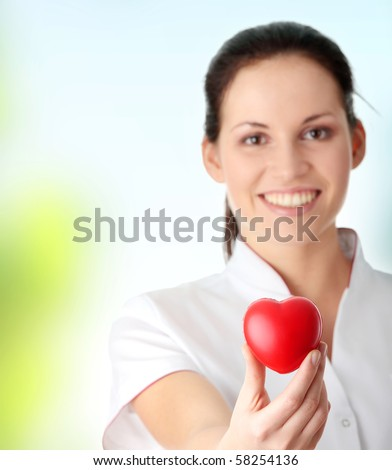 Young nurse with heart in her hand