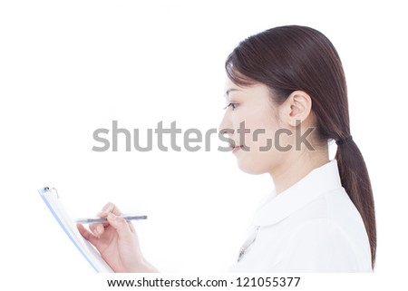 Young nurse writing chart, isolated on white background