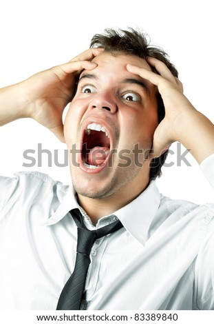 young office worker mad by stress screaming and holding head in hands isolated on white background