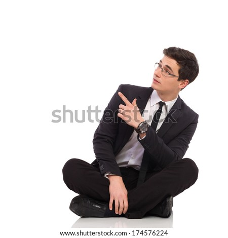 Young office worker showing copy space. Full length studio shot isolated on white.