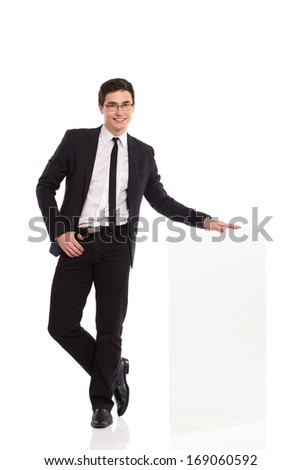 Young office worker standing and holding bar chart. Full length studio shot isolated on white.