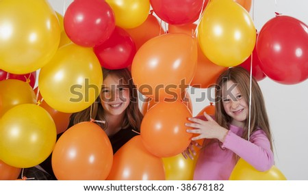 young old girls playing in balloons