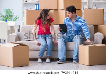 Young pair moving in to new house with boxes #793914214