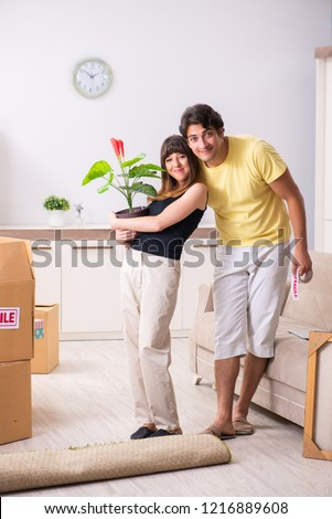 Young pair moving to new flat with fragile things  #1216889608