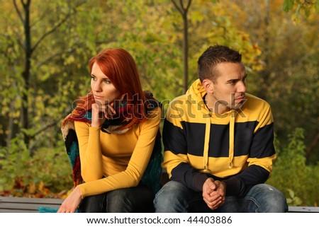 Young pair quarrel in park