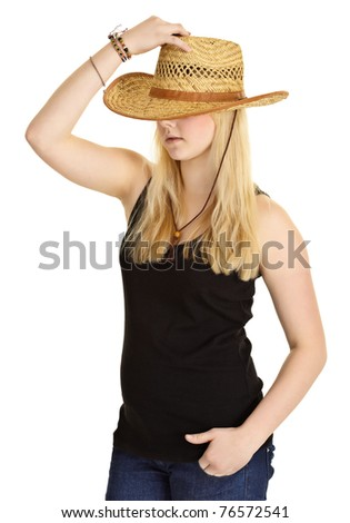 Young pale girl in old-fashioned straw hat isolated on white