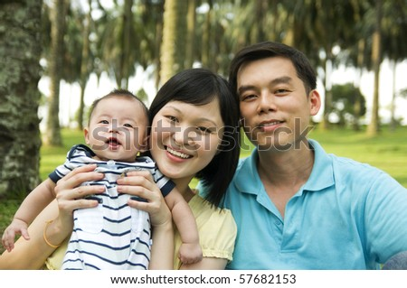 young parents and baby boy