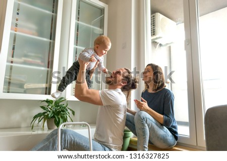 Young parents playing with baby #1316327825