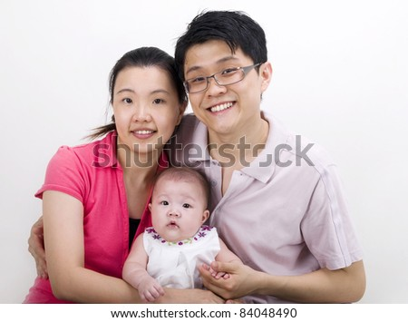 young parents with their baby girl - stock photo