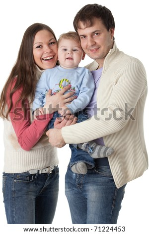 Young parents with their  sweet  baby on a white background. Happy family.