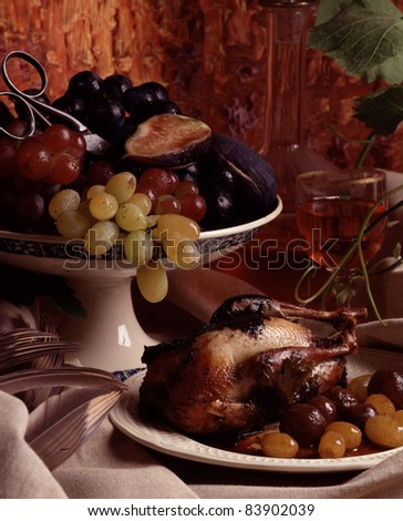 Young partridge with grapes