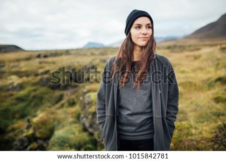 young peaceful woman enjoying...