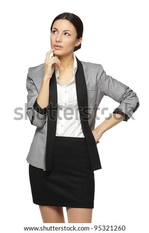 Young pensive female looking sideways, isolated on white background