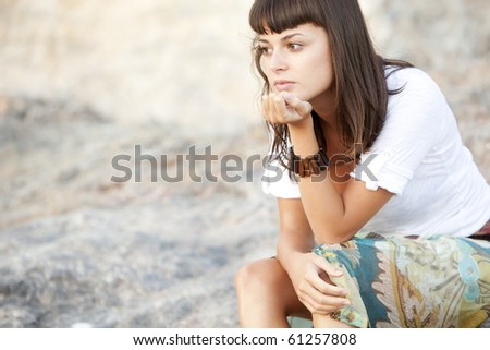 Young pensive woman close portrait in pensive gesture.