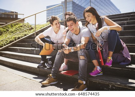 Young people and social media, outdoors. #648574435