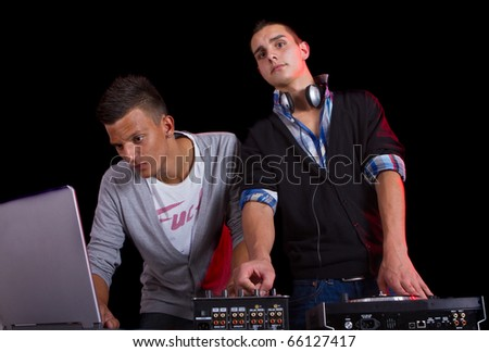 Young people at a party with two young djs.