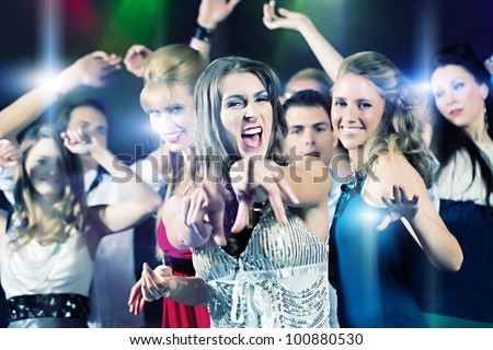 Young People Dancing In Club Or Disco Party, The Girls And ... |People Having Fun In A Club