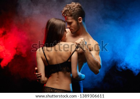 young people dancing striptease in the club. close up photo