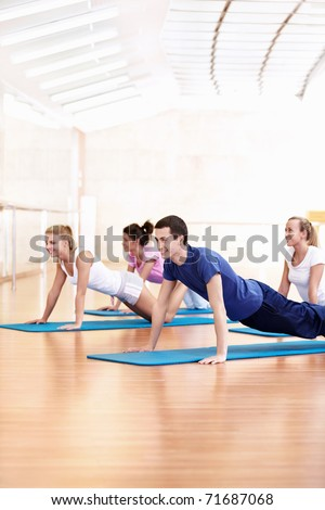 Young people do push-ups in the Gym