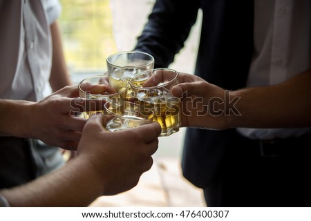 Young people drinking whiskey. Soft selective focus #476400307