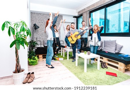 Young people employee workers having a break at start up coworking space - Fun business concept of human resources having relax time on working place - Startup entrepreneurs dancing at office party Photo stock ©