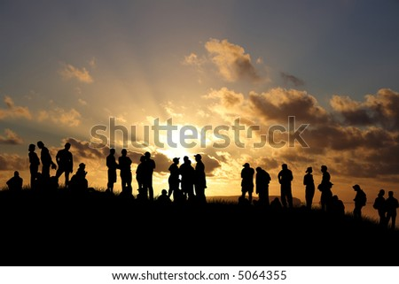 Young people enjoy in park at sunset