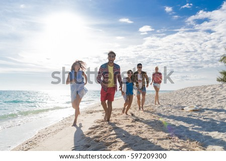 Young People Group On Beach Summer Vacation, Happy Smiling Friends Walking Seaside Sea Ocean Holiday Travel #597209300