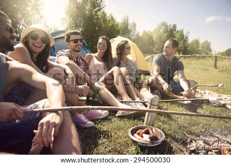 Young people having a camping