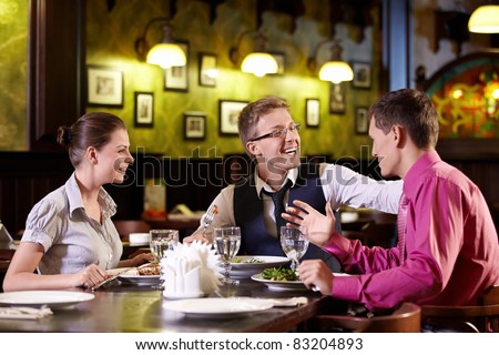 Young people having dinner at a restaurant