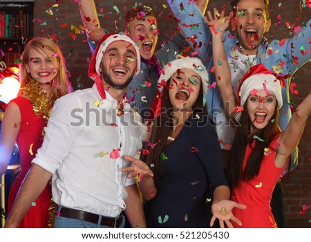 Young people having fun at Christmas party #521205430